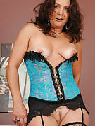 Brunette MILF Chane shows off her gorgeous vagina structures through pink lingerie
