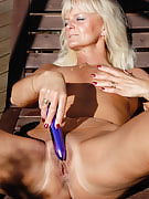 43 yr old golden-haired Jenny F slips her long purple vibrator deep in