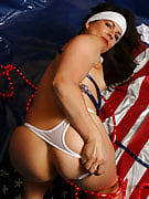 Adult brunette Andie performances of furry pussy the patriotic way