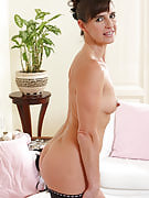 47 yr old Suzie strips away her black lingerie and fondels this girl cunny