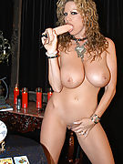 Kelly Madison tries to read your future with her big boobs.