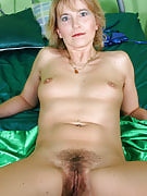 Kates fingertips her mature and additionally hairy pussy inside definitely one