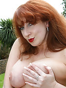 Busty and also redheaded MILF gets down and dirty inside the back yard