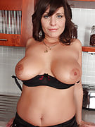 Sexy brunette housewife will get naked and additionally spreads as part of the kitchen