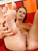 Cadence shows off her big titties then lotions the lady beautiful toes right here