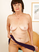 63 yr old Mona strips away her clothes showing moist crotch