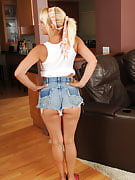 Blonde housewife Andi stops ironing and also strips off this girl denim shorts