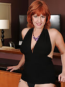 Redheaded 52 year old MILF Calliste strips off her elegant dress for your