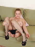 Horny blonde MILF Alyza Blue posing as part of great black colored fishnet stockings