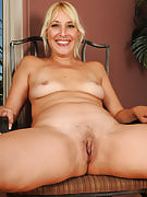 Hot blonde MILF Andi slips off her purple knickers and additionally spreads this girl pussy
