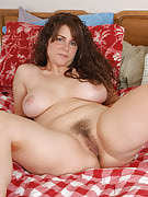 Tori strips in order to reavela big natural breasts and a packed bush