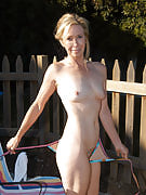Smoking cigarettes hot 54 yr old within the wooden for a tan