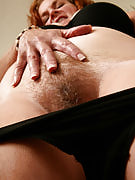 Busty and big Lucy The strips and spreads the lady hairy and also hot beaver