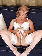 Lena F in white lace spreads her 57 12 months older vagina for the camera