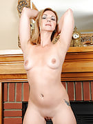 Mature and also gorgeous Samantha Rae posing naked as part of front of a fireplace