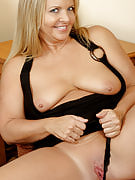 Horny blonde 50 year old playing with the lady shaven adult crotch