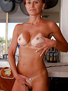 Redheaded MILF Kate spreads her restricted asscheeks in the kitchen area