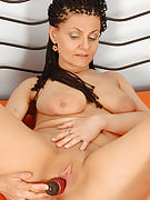 Hot mature darling S crams a purple dildo around her adult pussy