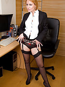 At 46 years of age Tiffany T still seems very good seated naked as part of the workplace