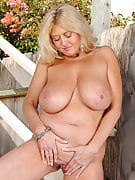 Blonde Tahnee Taylor showing away her huge melons within the backyard