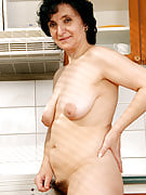 52 year old Sandra D concerts away her full tits and bush as part of her kitchen area