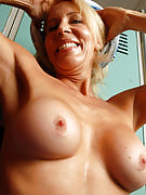 54 year familiar Erica works out and then spreads the lady hairy pussy for you