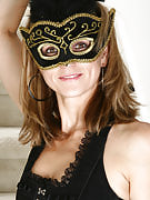 Veronica c plays dressup with a feather mask and an extended beat